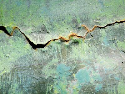Rusty Crack in Layers of Paint on Old Truck