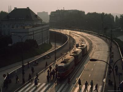 Pedestrians and Trams in Warsaw, Poland