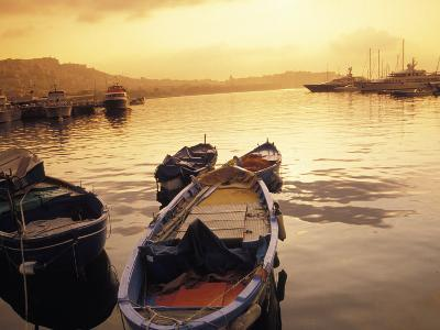 Sunset Setting over Two Boats at a Fishing Harbour and Marina on the Bay of Naples in Naples, Italy
