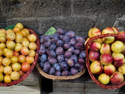 Three Baskets of Colorful Fruit at a Market in Siena, Tuscany, Italy