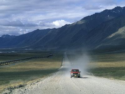 Truck on the Dalton Highway Following the Alyeska Pipeline, Alaska