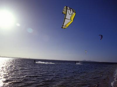 Three Kite Surfers on a Windy Summer Day Race Across a Bay, Australia
