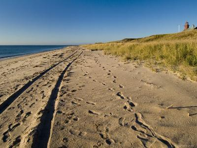 Tire Tracks and Footprints in the Sand Along a Beach by a Lighthouse, Block Island, Rhode Island