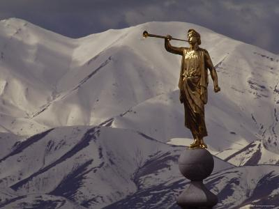 The Gilded Statue of the Angel Moroni against the Oquirrh Mountains, Utah