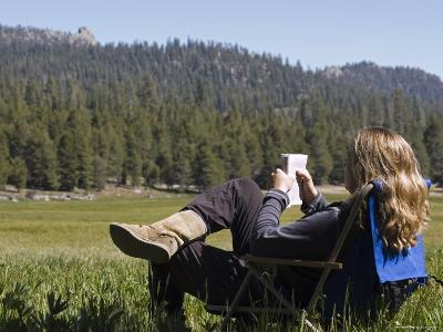 Woman Relaxing with a Book in Sequoia National Forest, California