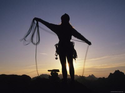 Women Coils a Climbing Rope in the Mountains of Idaho