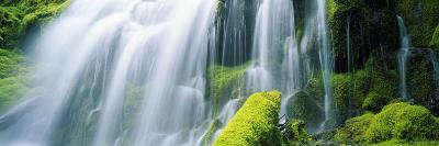 Close-Up of Waterfall on Moss Covered Rocks