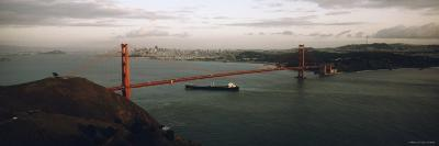 Barge Passing under Golden Gate Bridge, San Francisco, California, USA
