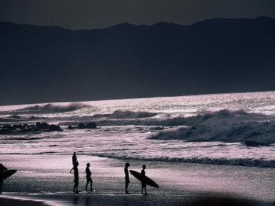 Surfers at Sunset, Ehukai, Oahu, Hawaii
