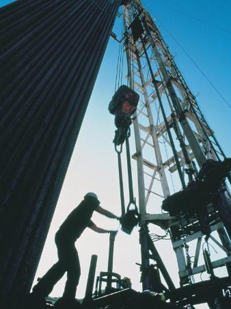 Roughneck Working on Oil Rig