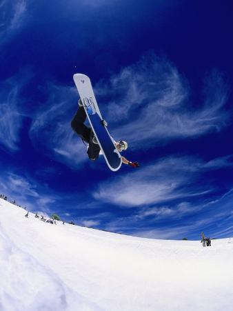 Snowboarder Doing a Trick in Midair
