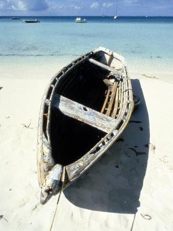 Wooden Row Boat Lying on Beach
