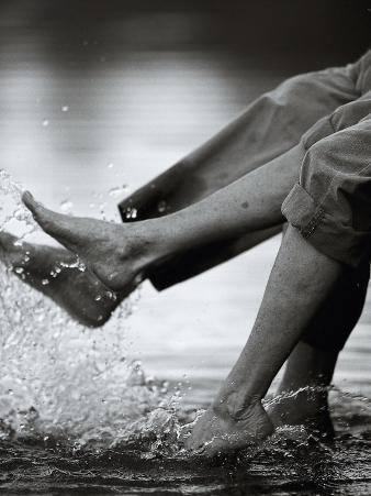 Couple Splashing Water withFeet