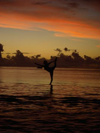Woman Doing Yoga in Water at Sunset, Tahiti