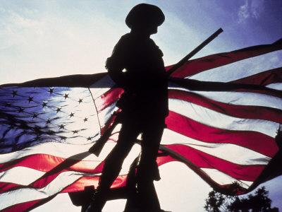 Silhouette of Soldier in Front of Flag