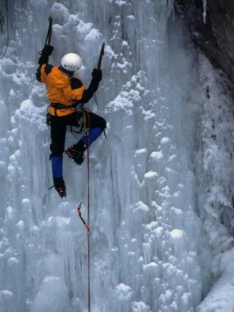 Man Ice Climbing at Ouray Ice Park, CO