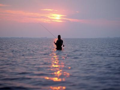 Man Fishing in Middle of the Water