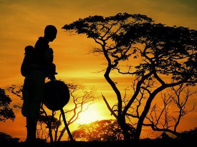 Woman and Child at Sundown, Botswana