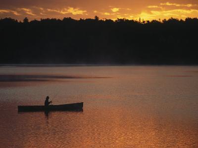 Man Fishing on Lake, Quetico Provincial Park