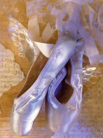Ballet Slippers Over Wings and Music Sheet