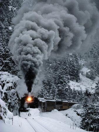 A Train Chugs Through the Snow Blanketing the San Juan Mountains