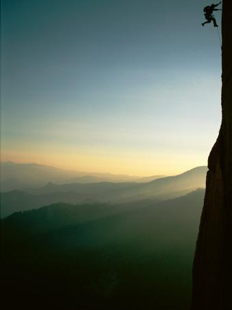 A Rock Climber from the 90 Degree Face of a Mountain Wall