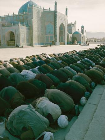 Afghan Men Pray Near the Mosque in Mazar-I-Sharif