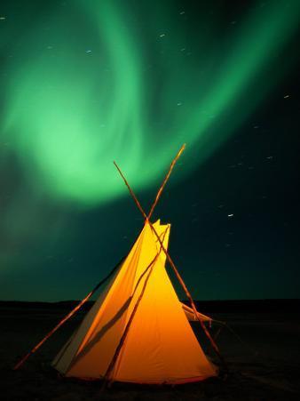 A Solitary Tepee is Illuminated by the Aurora Borealis