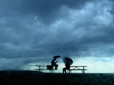 Tourists Sit on Picnic Tables While Waiting out a Storm