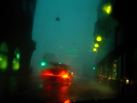 Misty View Of Car Lights On A City Street During A Rain Storm
