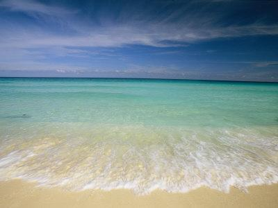 Clear Blue Water and Wispy Clouds Along the Beach at Cancun