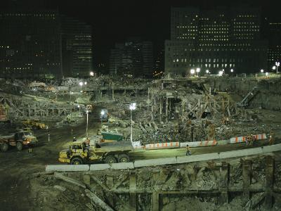 An Elevated View of Ground Zeros Devastation at Night; Crews, Their Vehicles, and Other Equipment