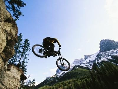 Man Jumping on His Mountain Bike with Ha Ling Peak in the Background