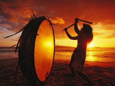 Native Hawaiian Man Beats His Drum on Makena Beach at Sunset