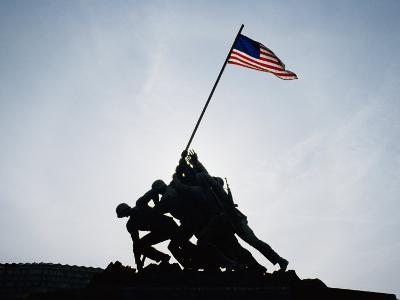 The Iwo Jima Memorial Silhouetted with Flag Flying