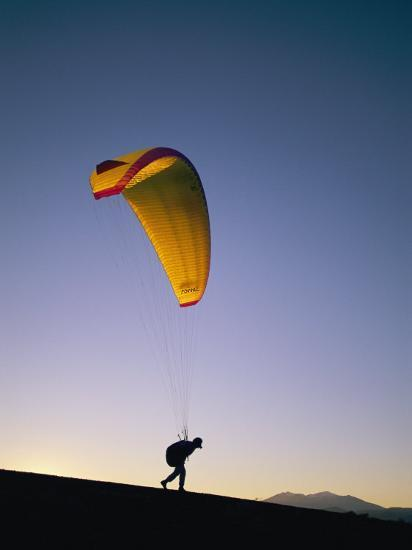 A Person Paraglides at Shiva Crater