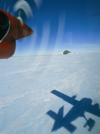 Prop Plane Casts a Shadow on the Ice Below