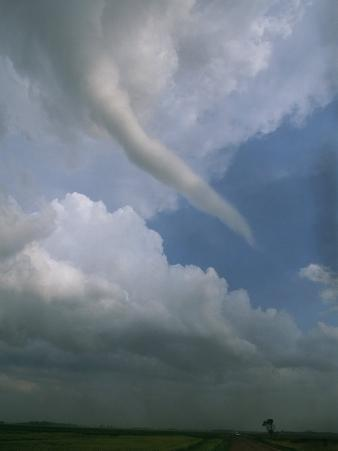 A Funnel Cloud Reaches Towards Earth from the Sky