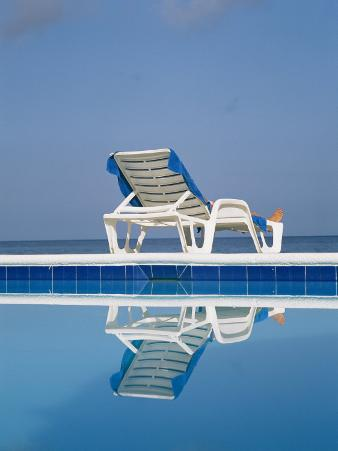 A Deck Chair Offers Poolside Relaxation to a Vacationer