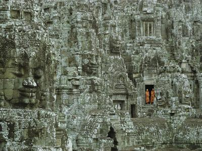 Buddhist Monks in a Doorway of the Ruins of the Bayon at Angkor