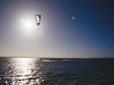 Kite Surfers Enjoying a Day on a Windswept Bay