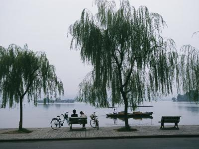 Bicyclists Enjoy the View in a Hangzhou Lakeside Park