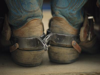 Close up Detail of Cowboy Boots with Well-Worn Spurs