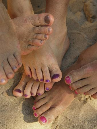 Cluster of Bare Feet with Painted Toenails