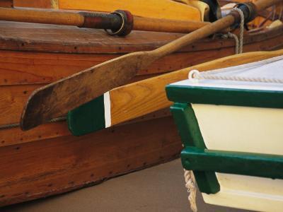 Two Boat Oars Interlocked on Shore