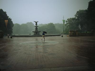 A Man Scurries Across Bethesda Terrace During a Rain Shower