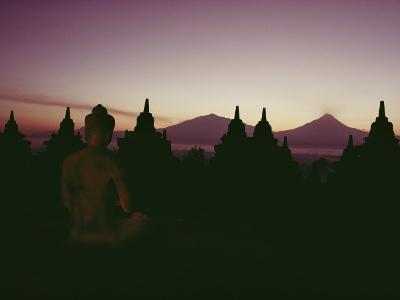 A Buddha Sits in the Silence Amid 1200-Year-Old Stupas at Borobudur