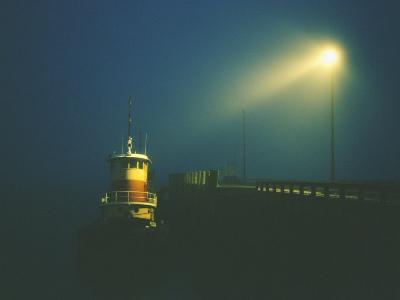 A Tugboat by the Dock