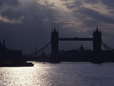 The Recently Renovated Tower Bridge is Nearly Silhouetted against a Cloudy London Sky
