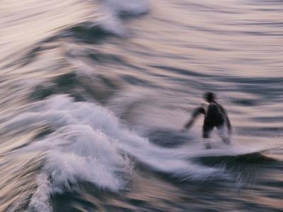 A Surfer Catches a Wave in Southern California